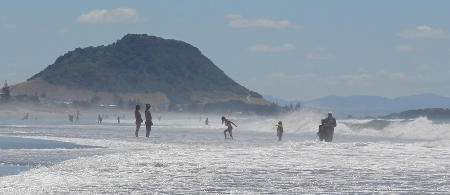 Family enjoying Mount Maunganui Beach, Bay of Plenty, New Zealand